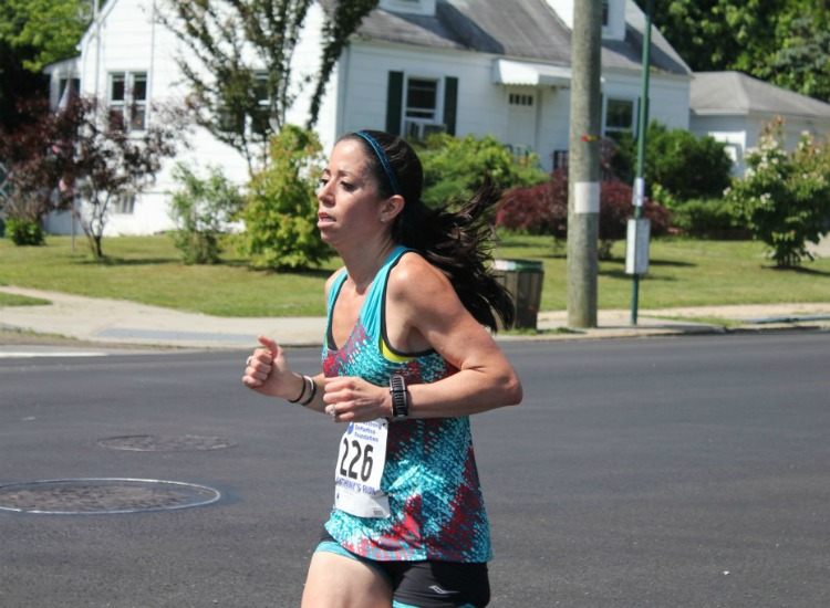 Fit Mama Friday - Meet Michele. SAHM to two gorgeous boys, Michele is a dedicated runner training for Boston. Being able to gut out tough training is helped by her past career, as a Captain in the US Army, with 3 deployments in Iraq, where her love of running began. (And in my opinion, if you're going to fall in love with running in 120 degree heat, it's probably going to be a life-long passion!) A Marathoner, Ultramarathoner and Ironman, Michele is most importantly a Mom!